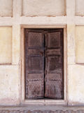 Old Wooden Door and White Wall Royalty Free Stock Photo