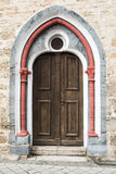 Old wooden door whith colorful border Royalty Free Stock Photo