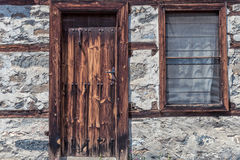 Old wooden door. And a window Stock Photography