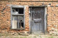 Old wooden door and window on abandoned home, Bulgaria Stock Image