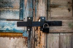 Free Old Wooden Door With A Heavy Lock Stock Photos - 164339293