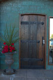 Old Wooden Door. Old wood and metal door on a cannery from 1885 royalty free stock photography