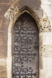 Old wooden door with wrought iron details. In Lisbon Stock Photos