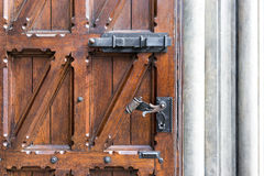 Old wooden door with wrought iron handle Stock Photography
