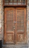 Old wooden door with wrought iron rivets Stock Images