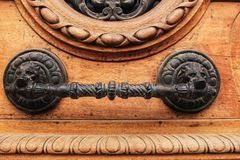 Old wooden door with wrought metal details.  Stock Photos