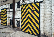 Old wooden door with yellow and black stripe Royalty Free Stock Photo