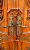 Old wooden doors with asymmetrically worn handles. Stock Photo