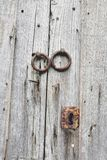 Old wooden doors with bronze handles and keyhole. Historical detail in the city center of Porto, Portugal Stock Photography