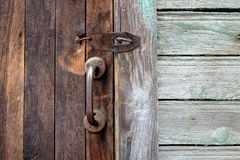 Old wooden doors with bronze handles and keyhole. Retro grunge background Stock Photos