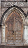 Old wooden doors of cathedral Stock Photo