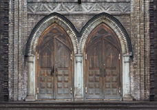 Old wooden doors of gothic cathedral Stock Photos