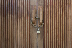 Old wooden doors locked with metal chain. And a padlock Royalty Free Stock Photography