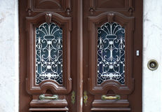 Ornate double doors. Old wooden doors with metal ornaments royalty free stock photography