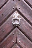 Old wooden doors with metallic knocker handle. Architecture concept, old fortification concept stock images