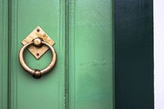 Old wooden doors with an old metal door handle. Knocker royalty free stock photo