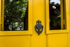 Old wooden doors with an old metal door handle knocker. In Paraty colonial city stock photos