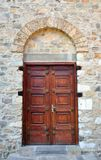 Old wooden doors. In the old stone building Stock Photography