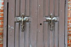 Old wooden doors with orthodox crosses at the entrance to the chapel as background. Structural painted wood with original crosses, traces of strong wear, in stock image