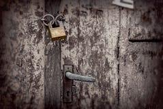 Old wooden doors padlocked closed Stock Photo