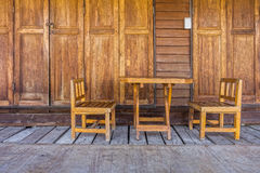 Old wooden doors, table, chairs and floor Royalty Free Stock Photos