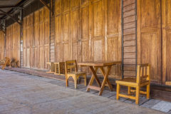 Old wooden doors, table, chairs and floor Stock Image