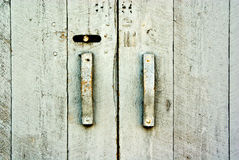 Old Wooden Doors Texture. Close-up of old, wooden doors with handles background texture royalty free stock photography