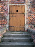 Old wooden doorway. On brick building, Auschwitz concentration camp, Poland Royalty Free Stock Images