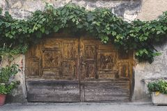 Old wooden double door on an old building royalty free stock photo