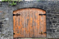 Old Wooden Double Door. This old wooden double door is a gate in a low stone wall; Limerick, Ireland royalty free stock photos
