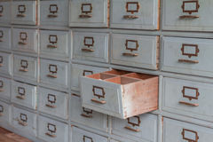 Old wooden drawers for storage is pulled out. Stock Photography