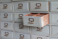 Old wooden drawers for storage is pulled out. Royalty Free Stock Photography