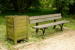 Old wooden dustbin and bench Royalty Free Stock Image
