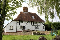 Old wooden dwelling house. In Northiam Sussex, England, United Kingdom. With timber framed cob first floor and a tiled roof. This is a listed building stock photography