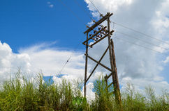 Old wooden elecric pole and power lines Stock Photos