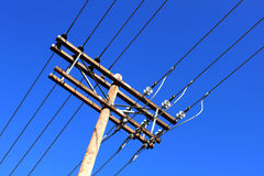 Old wooden electric pole Stock Photo