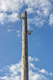 Old wooden electric pole. Against the blue sky and clouds royalty free stock image