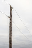 Old wooden electric pole with wires Stock Image