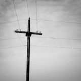 Old wooden electric pole with wires Stock Photos