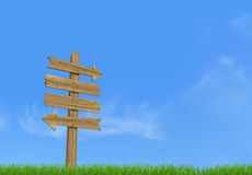 Old wooden empty sign post. On sky background - rendering Stock Image
