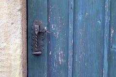 Old wooden entrance door with antique door handle Stock Images