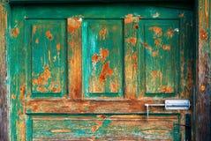 Old wooden entrance door with antique door handle Stock Photography