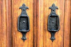 Old wooden entrance door with antique door handle Stock Photo
