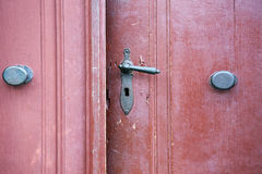 Old wooden entrance door with antique door handle Stock Photography