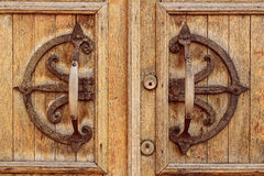 Old wooden entrance door with antique handle Stock Image