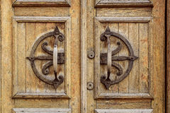 Old wooden entrance door with antique handle Royalty Free Stock Image