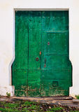 Old wooden entrance door. Old green wooden entrance door Royalty Free Stock Photo