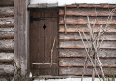 Old wooden facade with locked door Stock Images