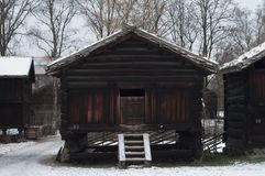 Old wooden farm houses in winter. Norwegian museum of history in Oslo capital of Norway Stock Photo