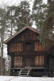 Old wooden farm houses in winter. Ethnic park in Oslo - capital of Norway Royalty Free Stock Photo